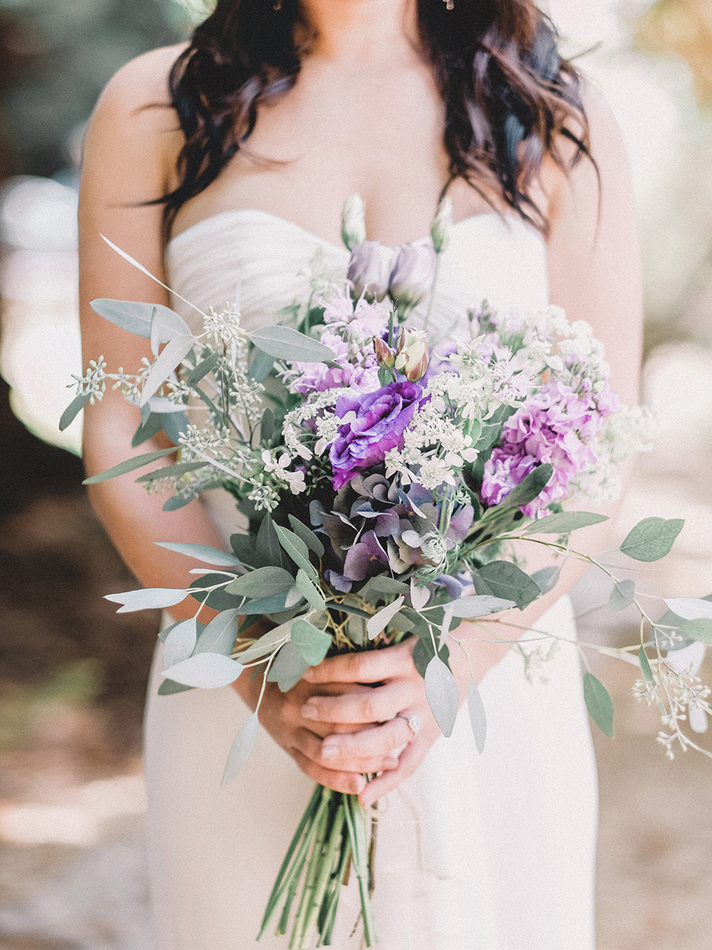 Bride holding the bouquet, fine art photography