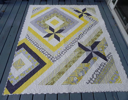 Wind Chimes Quilt designed by Wendy Sheppard for Windham Fabrics featuring Soleil by Whistler Studios