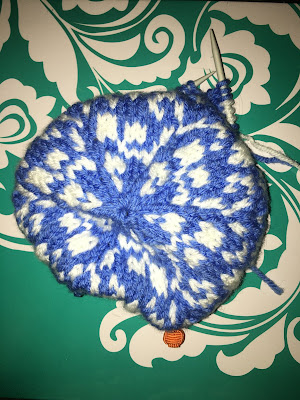 Blue and white stranded knitting on a circular needle