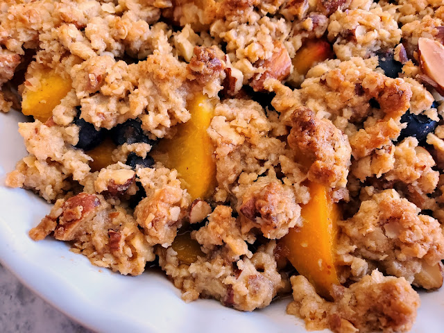 Peach Blueberry & Ginger Crisp:  Nothing tastes more like summer than juicy sweet peaches with bursts of tart blueberries laced with ginger, all topped with a crunchy buttery topping. - Slice of Southern