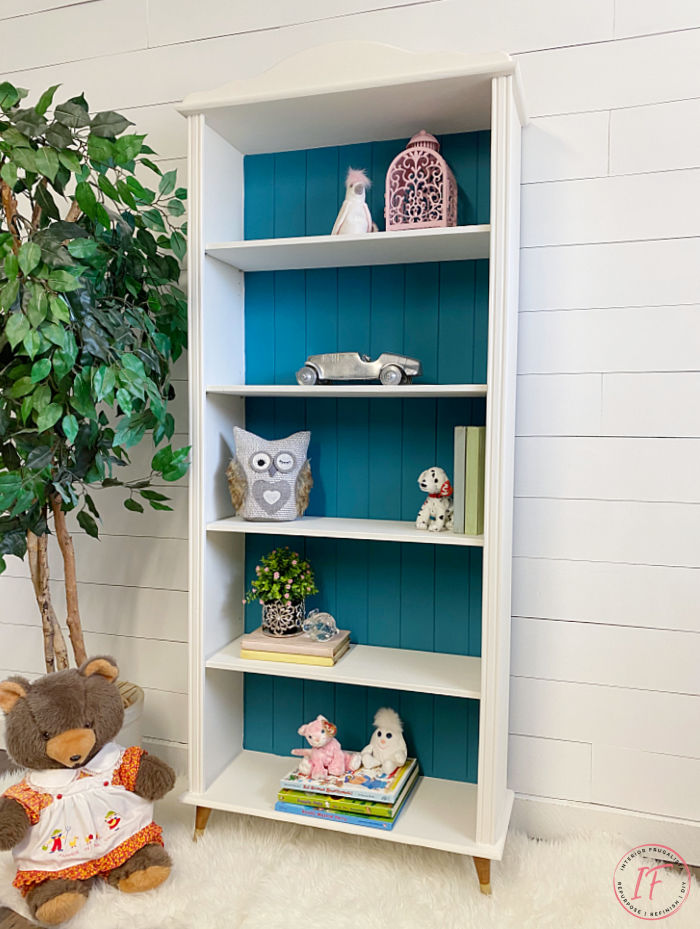 A small bookcase makeover for a baby nursery with mid-century modern style by replacing bun feet with vintage tapered wooden feet for a new look.