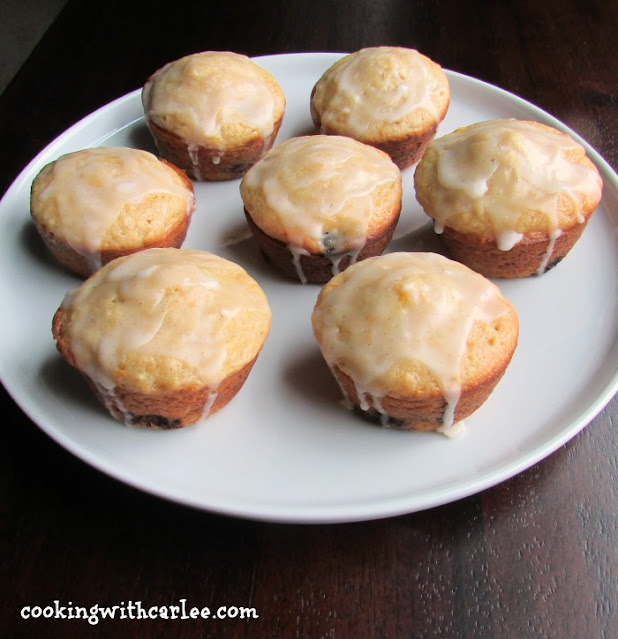 plate of muffins with white glaze on top