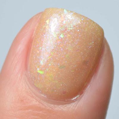 buff creme nail polish with flakies swatch