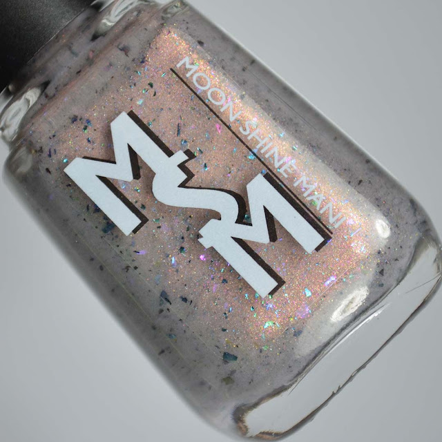 taupe nail polish with shimmer and flakies in a bottle