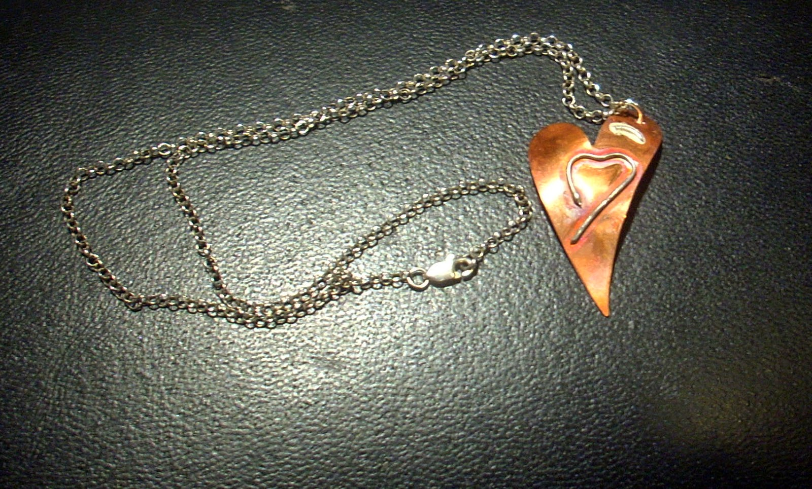http://www.wowthankyou.co.uk/vintage-beadery/products/open-heart-silver-on-copper-pendant/