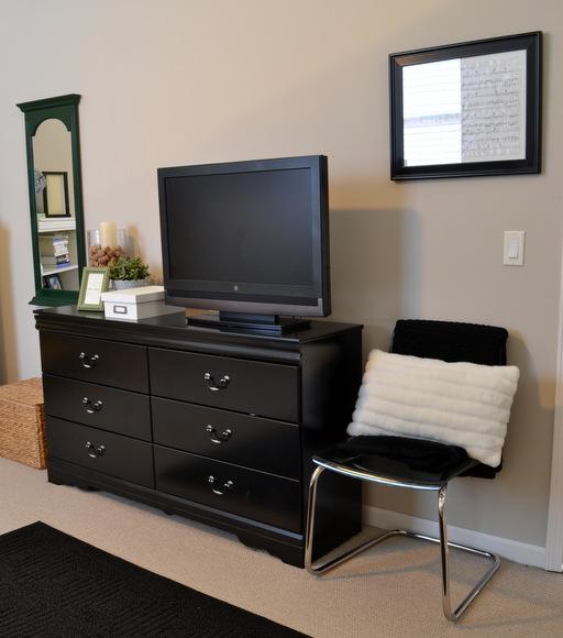 black dresser and television
