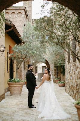 bride and groom walking at bella collina