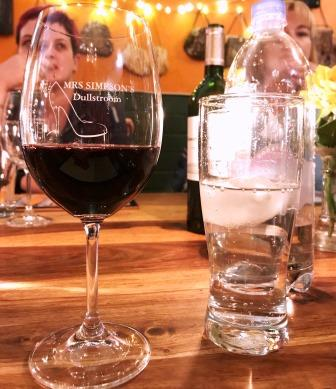 Wine glass marked Mrs Simpson's and glass of water at Mrs Simpson's