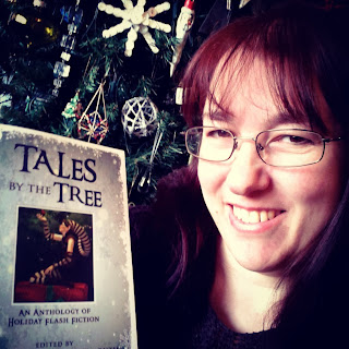 Image of Lisa with a copy of Tales By The Tree