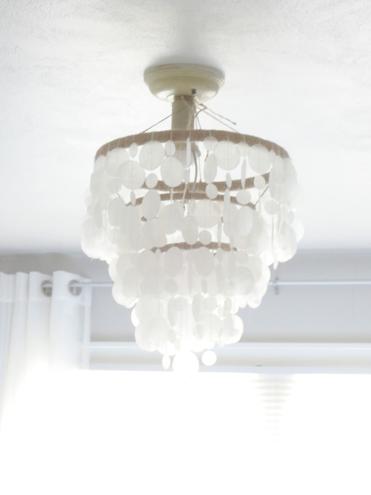 Beyond the portico faux capiz shell chandelier diyper cheap anyway here is a somewhat short tutorial in case you want to make one of these gorgeous faux capiz shell chandys for yourselfor a friendor just aloadofball Images