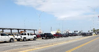 rows of cars and trucks waiting to board the ferry boat