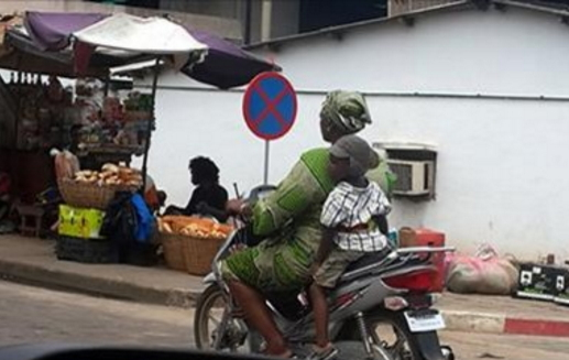 mother riding okada son