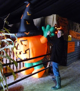 Getting a high-five off of a giant inflatable pumpkin witch