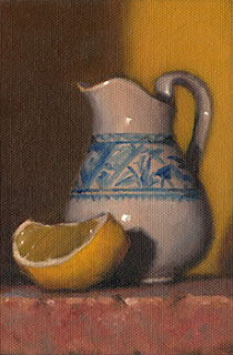 Still life oil painting of a blue and white porcelain jug beside a lemon quarter.