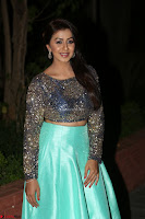 Nikki Galrani in Green Skirt  Top at Marakathamani music launch ~  Exclusive (45).JPG