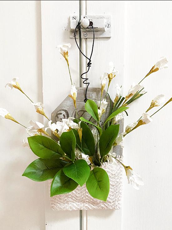 flower pocket hanging from vintage knob