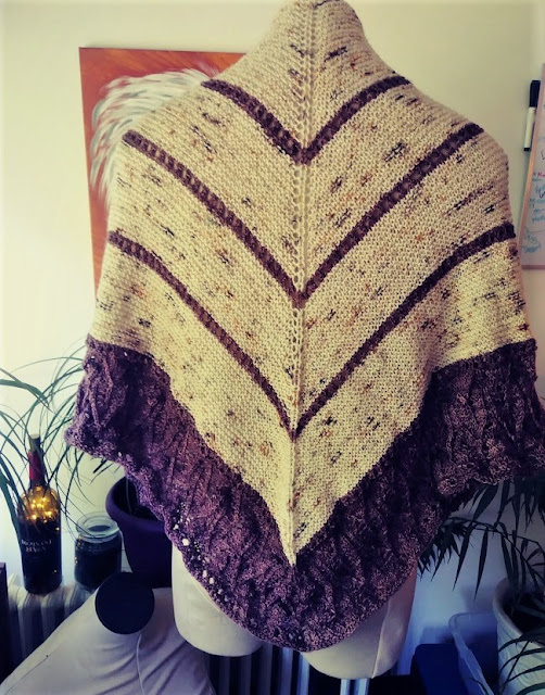 Simple garter stitch and lace shawl knit with fingering weight wool from Cozy Color Works.