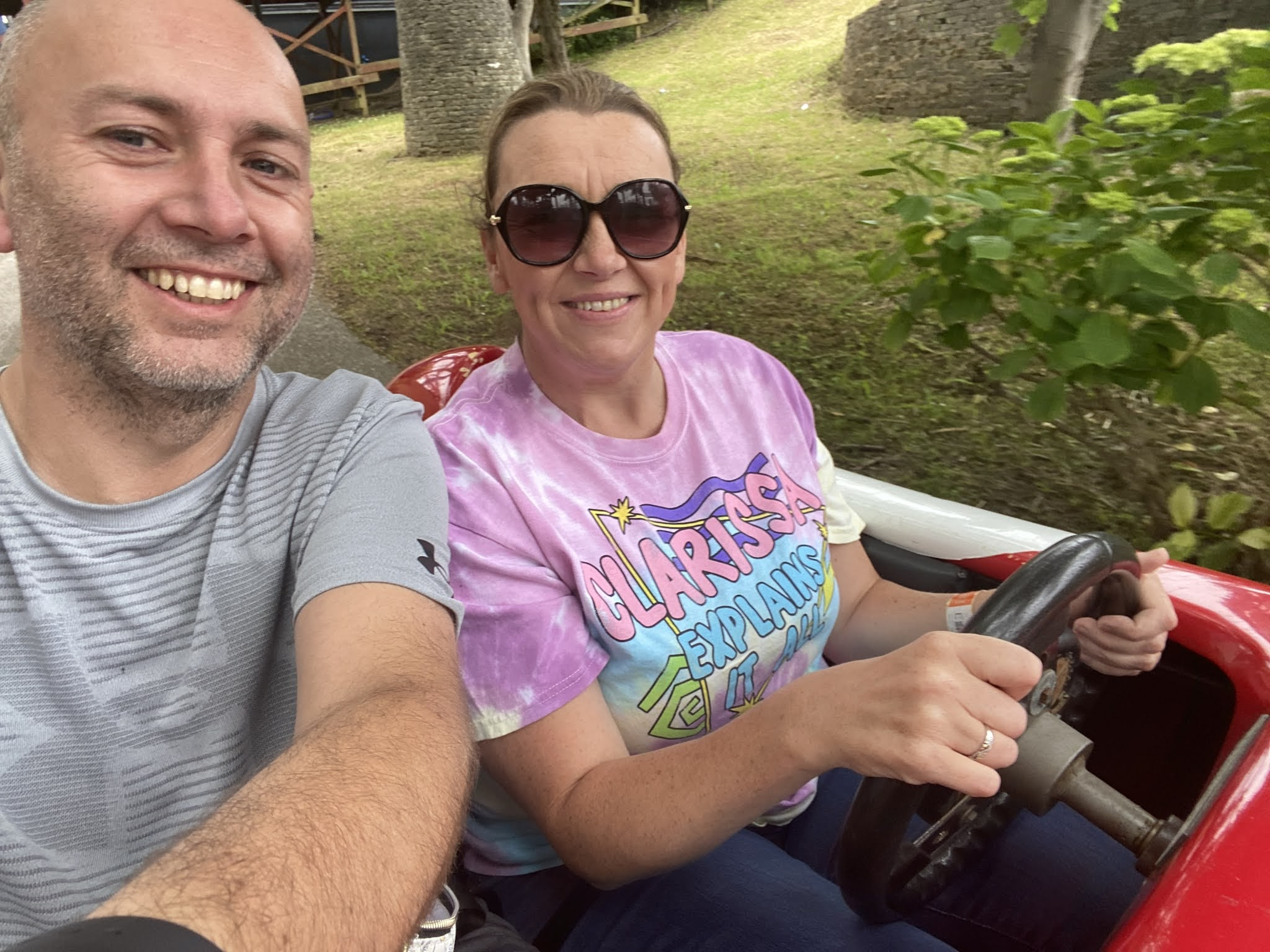 man and woman in a fairground car