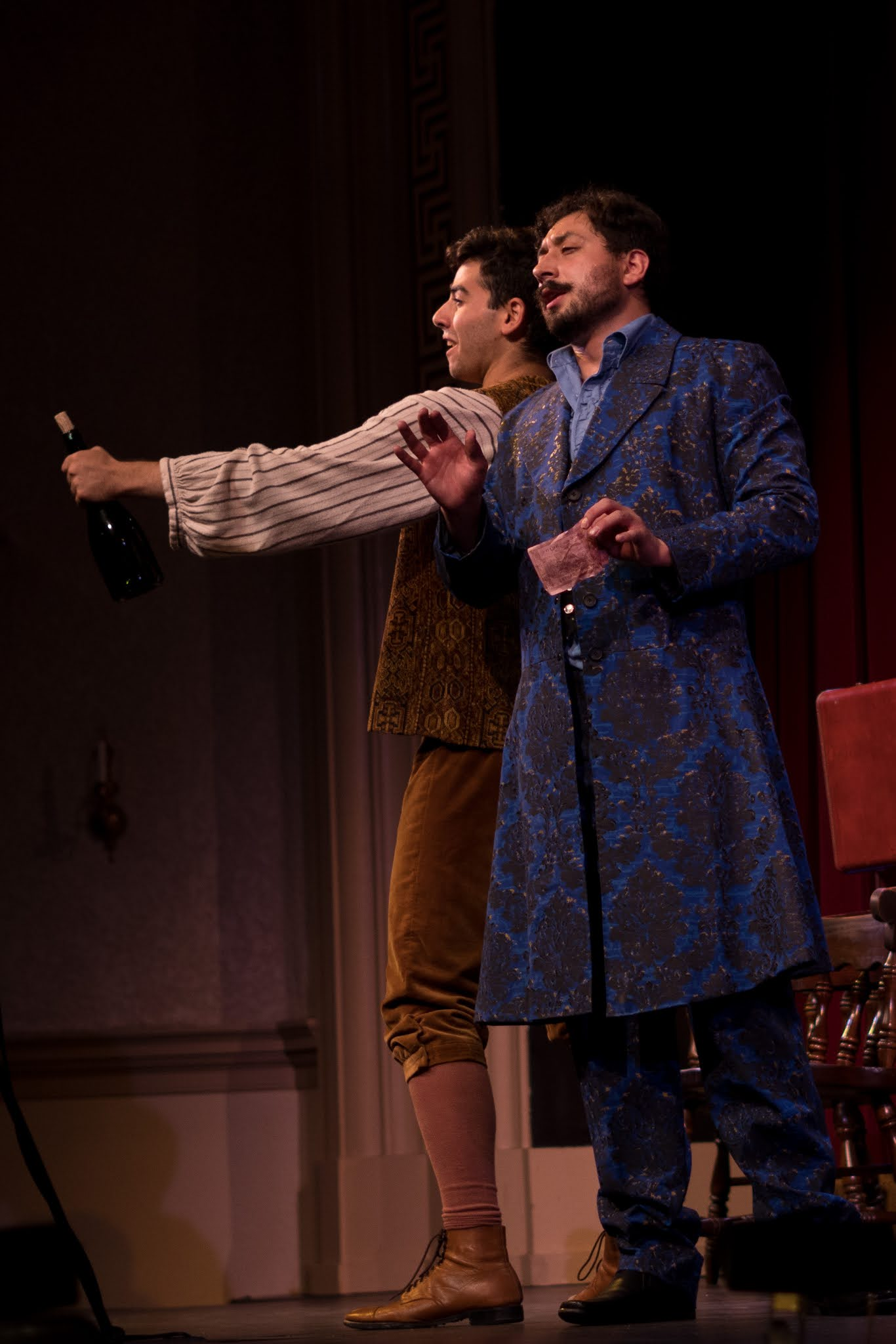 IN REVIEW: tenor JORDAN COSTA as Nemorino (left) and bass OLIVER POVEDA-ZAVALA as Dulcamara (right) in the Sapphire Cast of Opera in Williamsburg's September 2021 production of Gaetano Donizetti's L'ELISIR D'AMORE [Photograph © by Diego Valdez]
