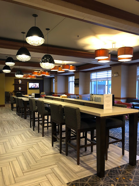 A spacious breakfast area invites reposing at Radisson on John Deere Commons.