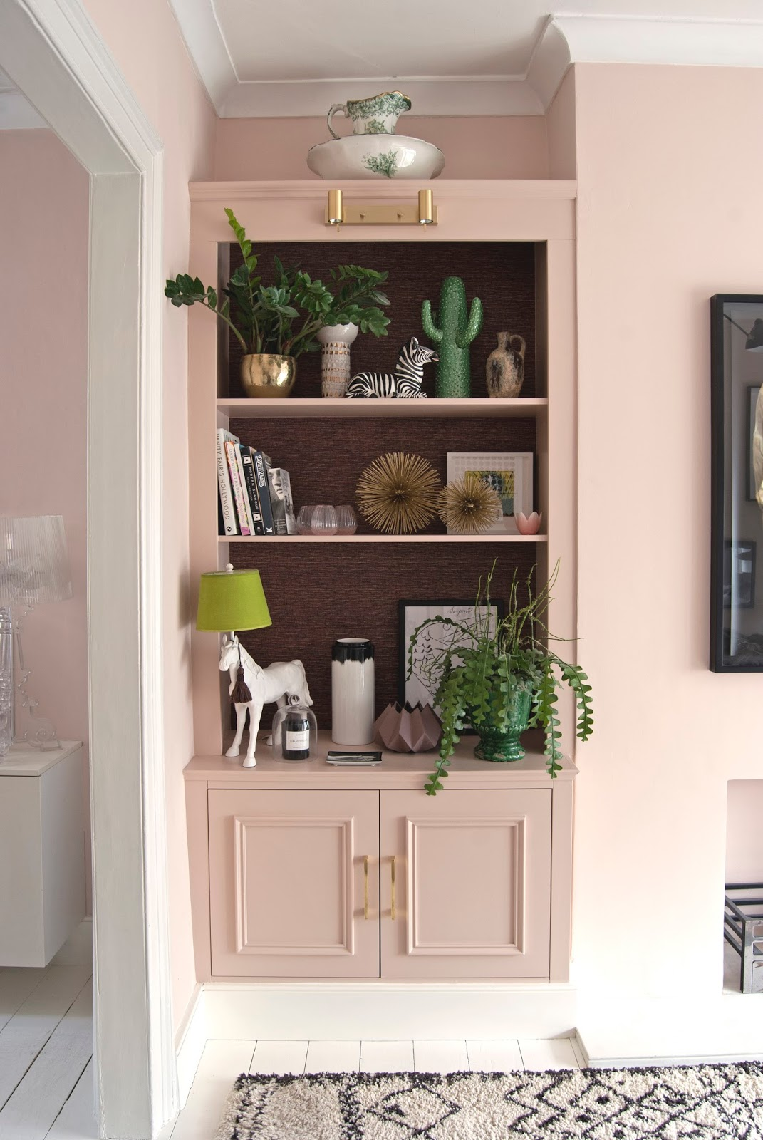 Amara Shoppable Home Inspiration Pages - French For Pineapple Blog - alcove shelving - setting plaster and pink ground walls, farrow and ball, horse lamp and plants