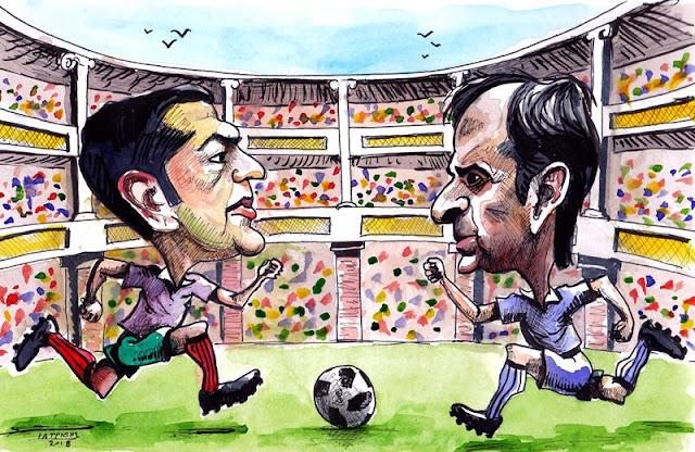 """Ματς τελικού Τσίπρας Μητσοτάκης είναι το θέμα της γελοιογραφίας του IaTriDis για την κρητική εφημερίδα """"Άποψη του Νότου"""" με αφορμή την προ ημερησίας συζήτηση στην βουλή και τον καυγά που ακολούθησε εν μέσω παγκοσμίου πρωταθλήματος ποδοσφαίρου στη Ρωσία."""