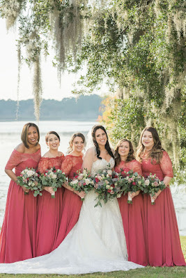 bride and bridesmaids in wine red