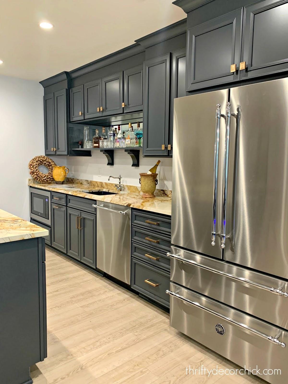 Dark blue gray basement bar cabinets