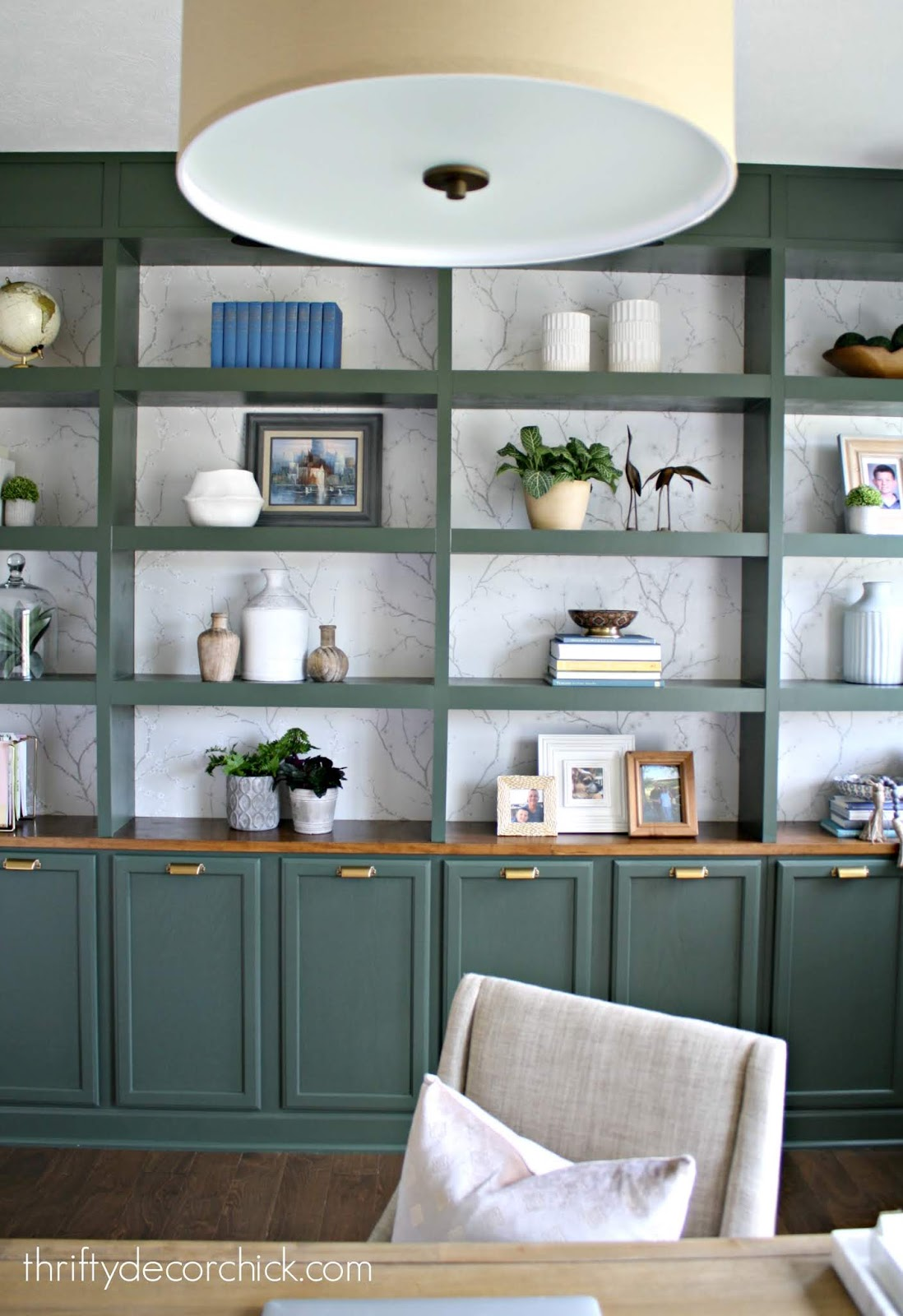 Dark green bookcases