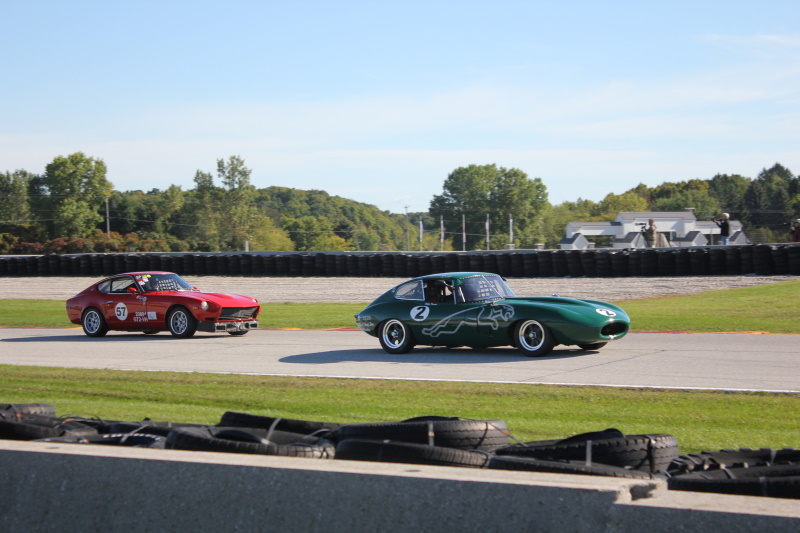 Coming out of turn 14 a '64 Jaguar XKE pulls away from the '72 Datsun 240Z