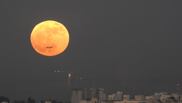 moon rise and an airplane