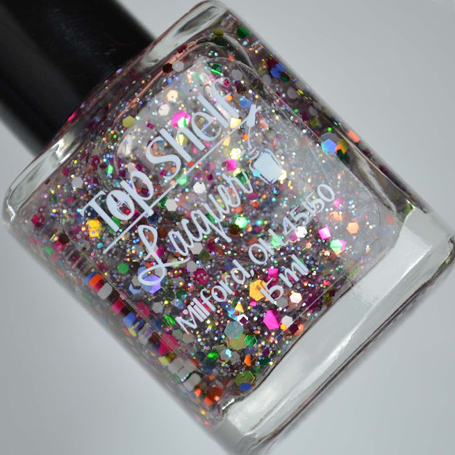 rainbow glitter nail polish in a bottle