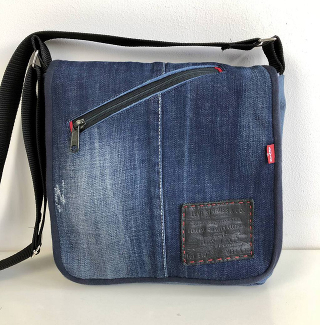 Learn how to upcycle a pair of jeans into a messenger bag. Tutorial by Vicky Myers Creations