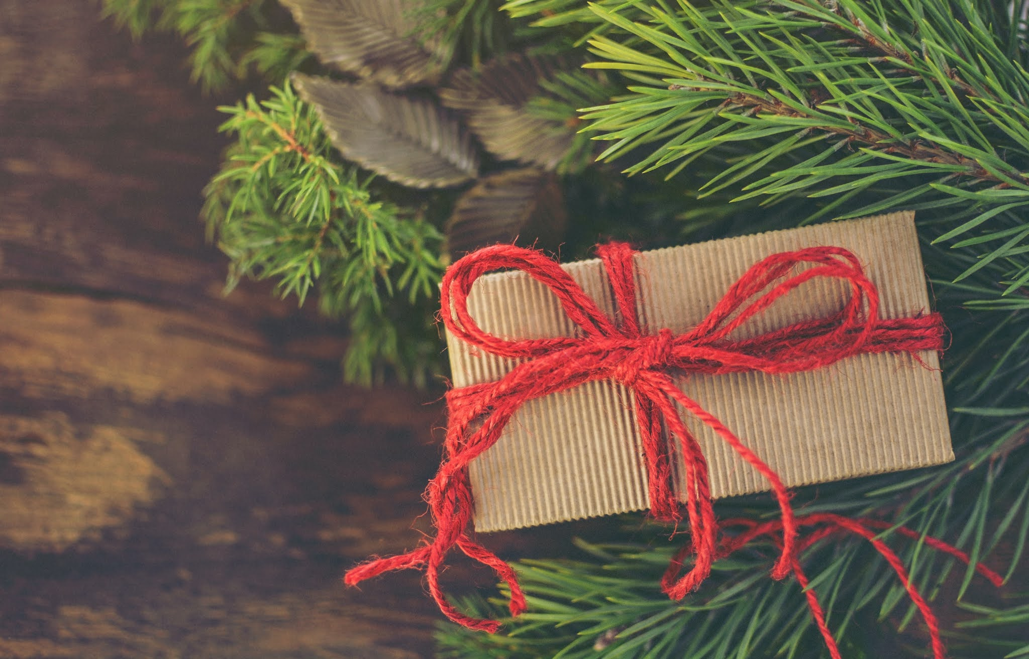 wrapped present in brown paper tied with red string