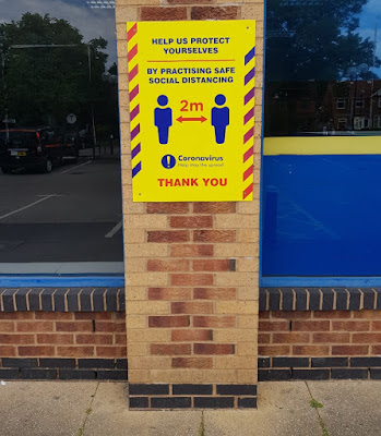 Social distancing signs at Blockbuster Video in Fallowfield, Manchester