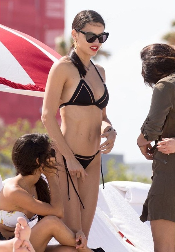 Adriana Lima displays hot body in string bikini on the beach
