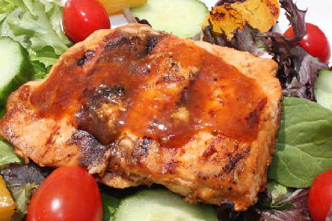 this is salmon with barbecue sauce on chef salad