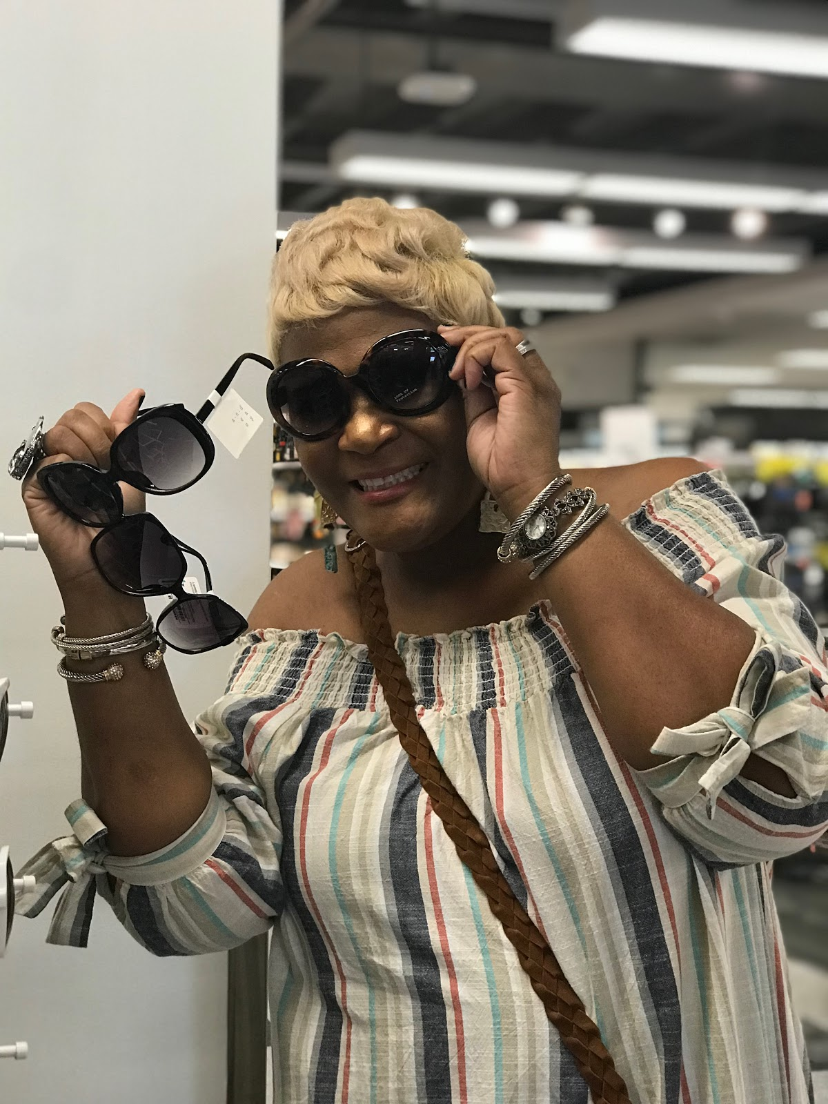 Image: Tangie Bell trying on new shades at Target. seen first on Bits and Babbles Blog. My second stop was at Target, but I had a hard time finding cute dresses that I wanted to rock so I may try my luck at it on another day.