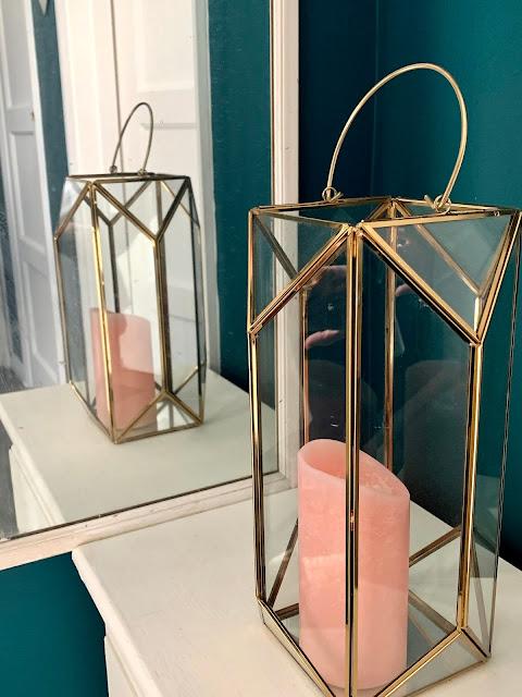 teal walls and gold lantern
