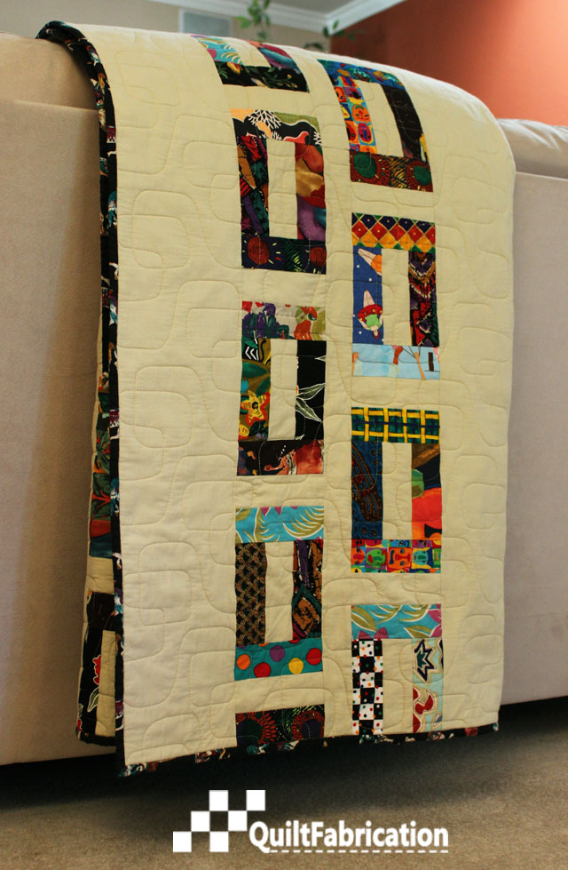 Slots quilt by QuiltFabrication draped