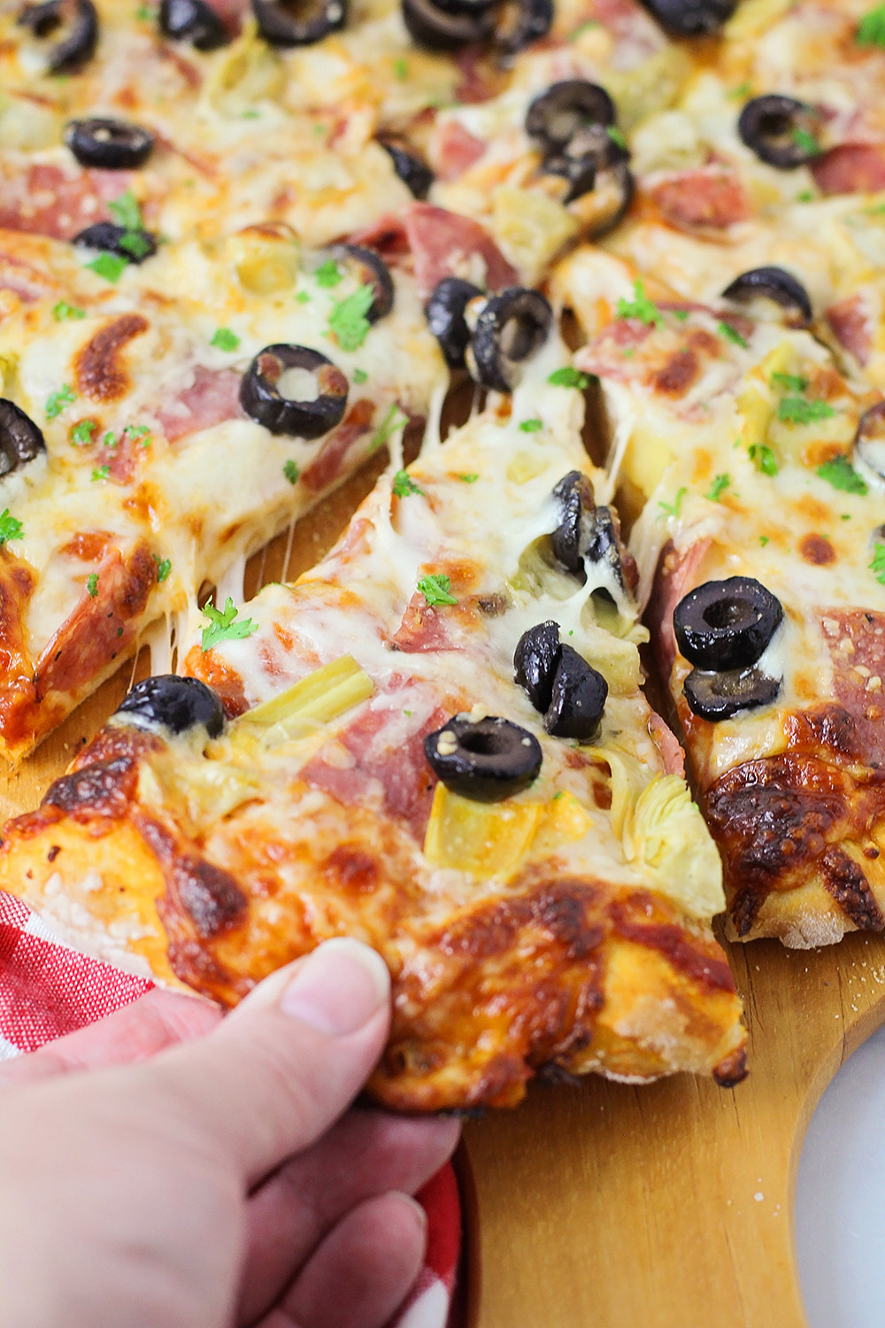 This savory made from scratch antipasto pizza is loaded with delicious flavors!