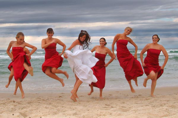 These Dresses Provide A Stunning Contrast Against The Blue Of Ocean For Beautiful Beach Wedding