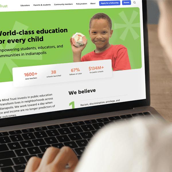 An Indianapolis teacher views The Mind Trust's nonprofit website on a laptop