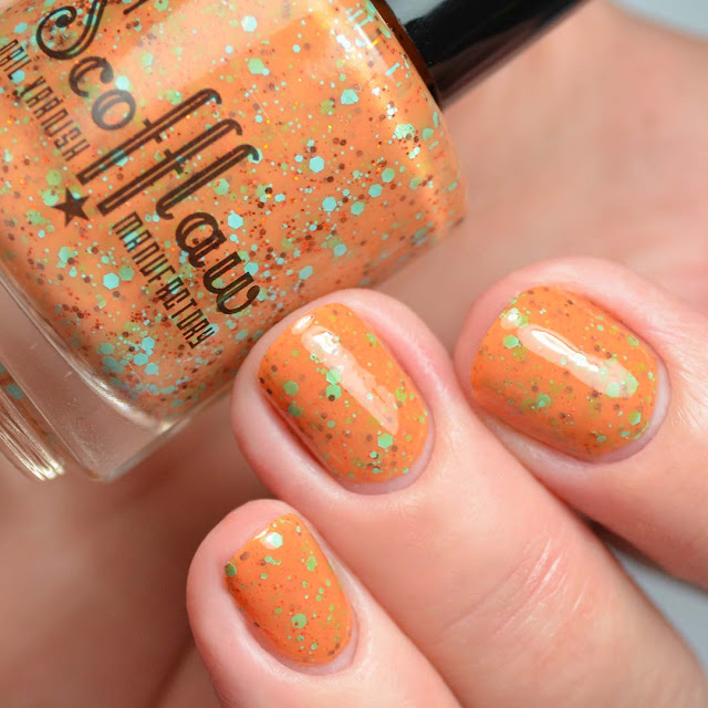 orange nail polish with colorful glitter three finger swatch