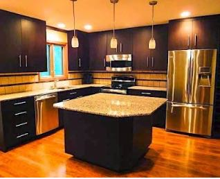 Kitchen with large granite top island.