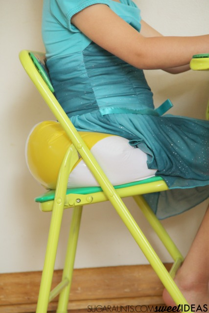 Cheap sensory seating hack to help kids with attention, fidgeting needs, and sensory vestibular sensory input needs. This sensory hack is perfect for kids with SPD, and neurotypical children, too.