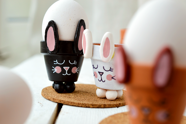 Two DIY Bunny Egg Cup made from a mini planter by Motte's blog looking at each other