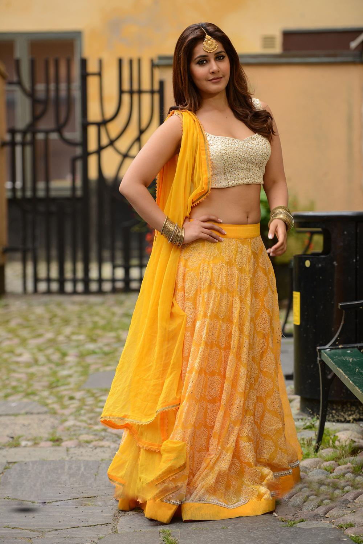 Rashi Khanna Hot Navel Stills In Yellow Dress