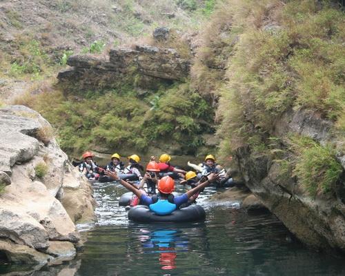 Tinuku.com Kalisuci cave tubing, down underground river in karst cave system landscape Sewu Mountains Geopark