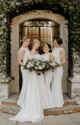 bride with bridesmaids in white